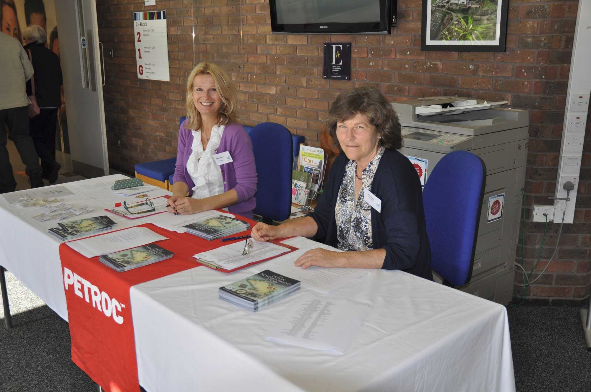 Dr Bridget Gillard (left) and Mrs Moira Aylett (right) at the reception desk