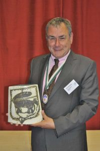 The Devonshire Association's outgoing President Dr Todd Gray MBE with his farewell gift of a decorated ceramic plate