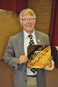 The Devonshire Association's outgoing Vice Chairman Prof. John Mather with his farewell gift of a decorated ceramic plate